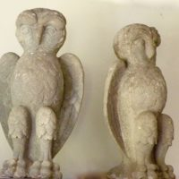 pair of carved limestone owls