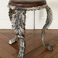 early c19 cast iron stool with new leather cover