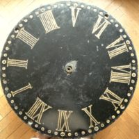 carved slate clock face converted to a low table
